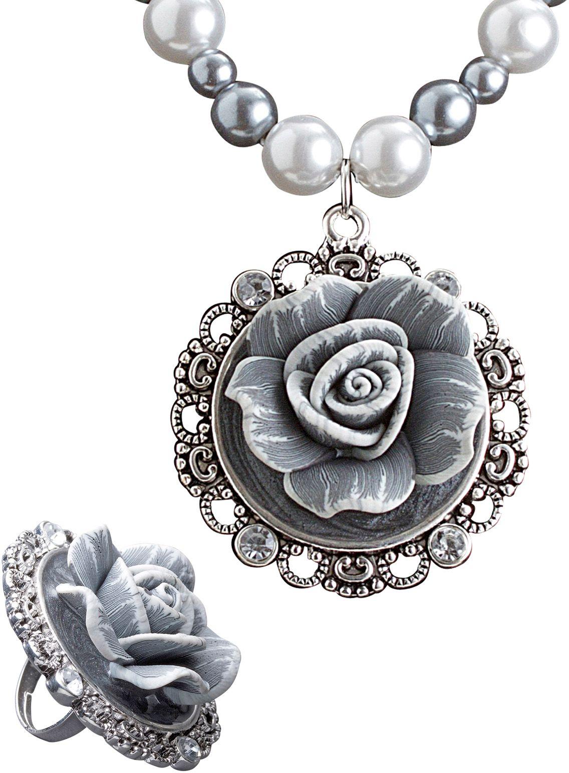 Geparelde ketting met roos